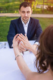 Young man making a proposal of marriage. Love, couple, date, wedding concept. Stock Images