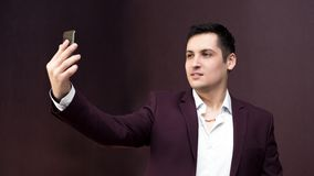 A man in a suit takes pictures of himself stock image