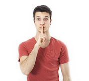Young man making silence gesture Royalty Free Stock Image