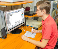 Young man making a sketch drawing on a computer Stock Photography