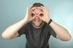 Young man making a spectacles gesture Stock Photography