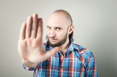 Young man making stop gesture Stock Images