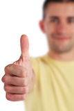 Young man making thumbs up sign Stock Photography