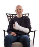 Young man making a thumbs up sign with his casted arm Royalty Free Stock Photos