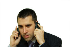 Young man making two calls Royalty Free Stock Photography