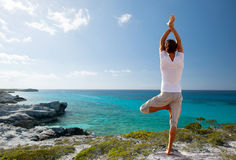 Young man making yoga exercises outdoors Stock Photography