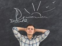Young man man dreaming about vacation near ocean stock photography