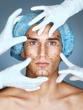 Young man with many surgical hands stock image