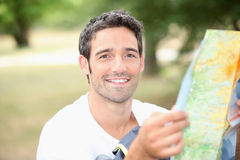 Young man with map Stock Photos
