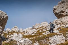 Young man with map in italien dolomites, loving nature and climbing, tre cime di lavaredo Royalty Free Stock Images