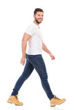 Young man marching in jeans and white t-shirt Royalty Free Stock Photos