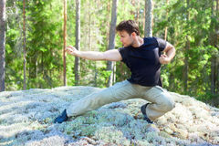 Young man martial art training Stock Images