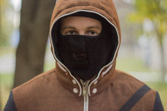 Young man in mask. A young man in a mask on the background of nature Stock Photos