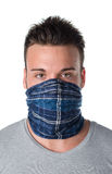 Young man masked as robber or bandit Stock Image