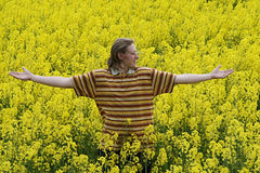 Young man in meadow Stock Images