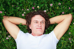 A young man among meadows. Royalty Free Stock Photo