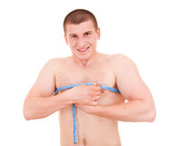Young man measures his chest Stock Images