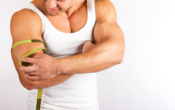 Young man measuring his biceps Stock Photography