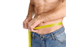 Young man measuring his waist. Stock Images
