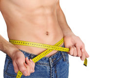 Young man measuring his waist. Stock Photography