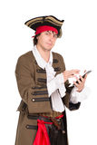 Young man in medieval costume. Posing with a tablet. Isolated on white Royalty Free Stock Photography