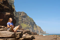 Young man meditates against sea-misty mountain Royalty Free Stock Photography
