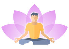 Young man meditates in the lotus pose with lotus flower. Royalty Free Stock Images