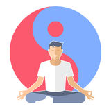 Young man meditates in the lotus pose with yin-yang sign. Stock Images