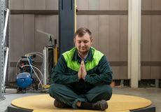 A man meditates after a hard day`s work stock image