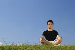 Young man meditating Royalty Free Stock Photo
