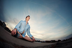 Young Man Meditating Stock Photos