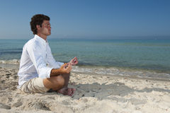 Young man meditating Stock Photography