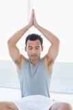 Young man meditating with eyes closed and joined hands Royalty Free Stock Images
