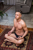 Young man meditating on his living room floor Royalty Free Stock Photo