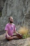 Young Man Meditating Outdoors Stock Image