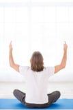 Young man meditating Royalty Free Stock Image