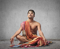 Young man meditating Stock Images