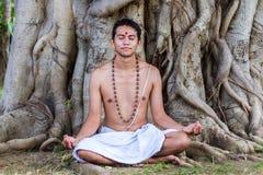 Young man meditating Royalty Free Stock Photos