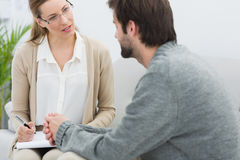 Young man in meeting with a psychologist Royalty Free Stock Photos