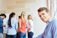 Young man in meeting with start-up team Stock Photo