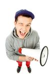 Young man with megaphone. Young man over white background Royalty Free Stock Photo