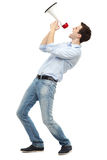 Young man with megaphone. Young man over white background Royalty Free Stock Photos