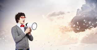 Young man with megaphone Stock Photography
