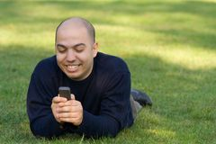 Young man messaging on the mobile phone Royalty Free Stock Images
