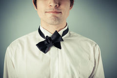Young man with messy bow tie. Young man does not know how to tie a bow tie stock photo