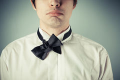 Young man with messy bow tie. Young man does not know how to tie a bow tie royalty free stock photography