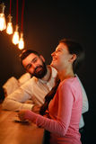 Young man met behind the bar with girl in nightclub Stock Photography
