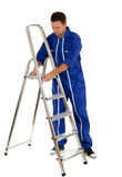 Young man with metal ladder Stock Photography