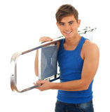 Young man and metal ladder Stock Images