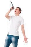 Young man with microphone Royalty Free Stock Photos